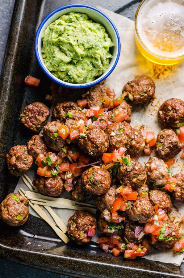 Mexican Meatballs on a tray with guacamole on the side