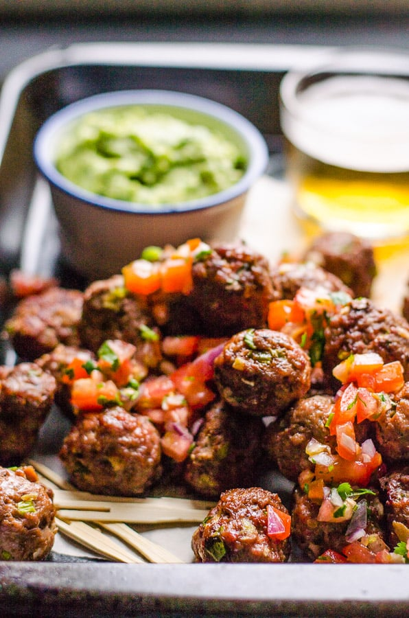 Mexican Meatballs garnished with diced tomatoes, onions and cilantro