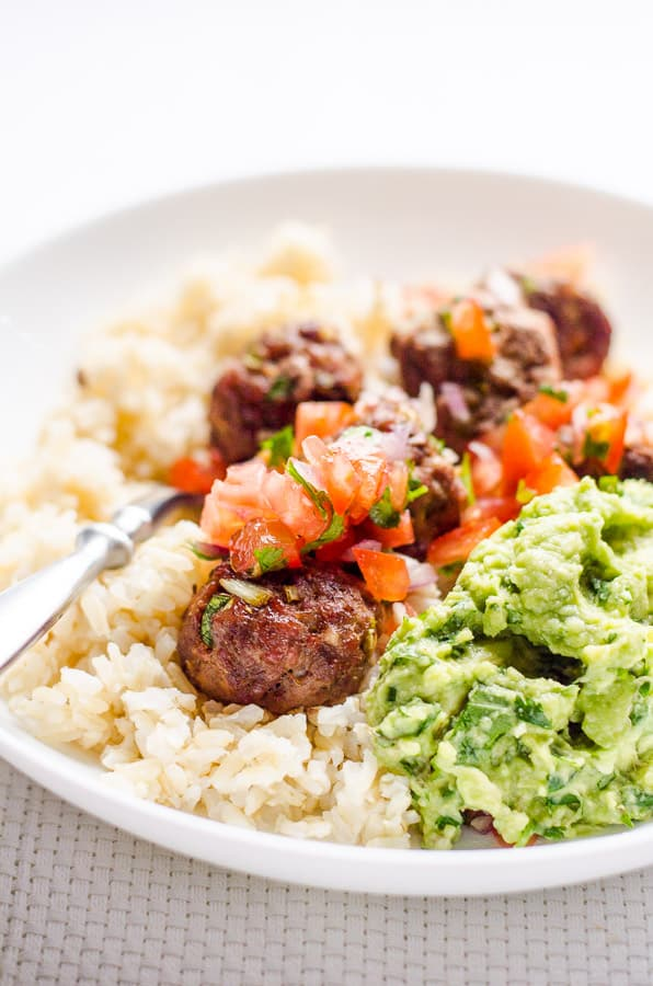 Super easy and juicy Mexican Meatballs Recipe with ground turkey, bake for 15 minutes, then serve with rice for an easy healthy dinner or as an appetizer.