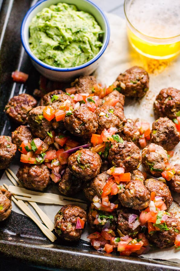 Healthy Game Day Recipes for you, so you don't sit on a couch starving or packing on lbs. Healthy game day dips, sliders, nachos, tacos, chili, pizza, bites and desserts ideas.