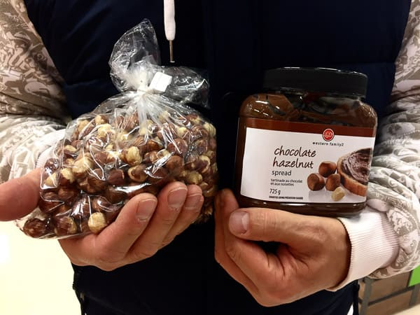 Bag of hazelnuts and container of Nutella