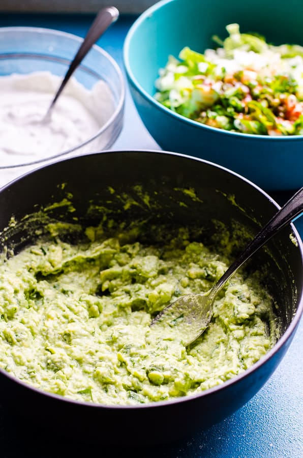 Buffalo Greek Avocado Yogurt Dip is a 3 layer dip recipe with hot sauce and romaine lettuce, Greek yogurt and blue cheese, and creamy avocado guacamole on top. | ifoodreal.com