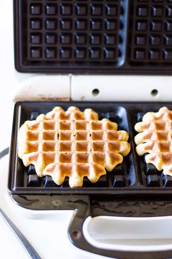 whole wheat waffles on griddle