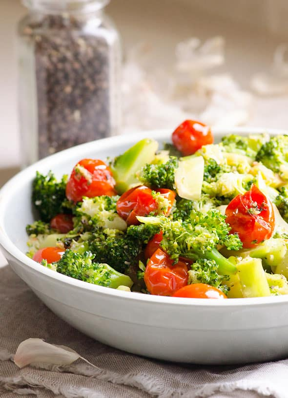 Sautéed Garlic Broccoli Recipe with coconut oil, freshly squeezed garlic, blistered grape tomatoes, sea salt and freshly cracked pepper. | ifoodreal.com