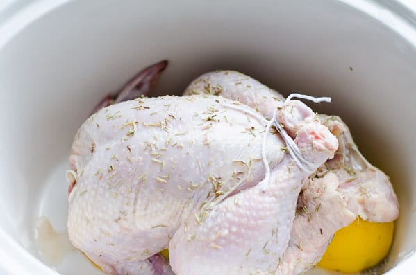 Slow Cooker Whole Chicken Recipe with garlic, lemon, rosemary and whole wheat pasta cooked right in the crockpot, then broiled for 5 mins. | ifoodreal.com