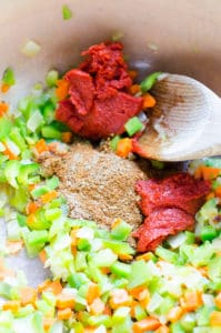 saute celery, carrots, onions, tomato paste and spices in pot