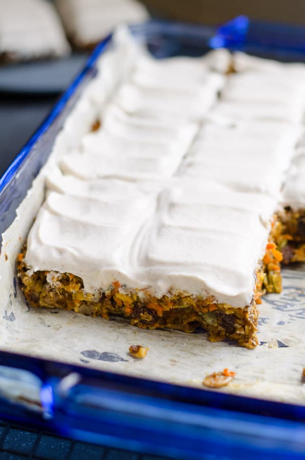 To die for healthy and easy Baked Oatmeal Breakfast Bars Recipe with applesauce, carrots, oats, chia, raisins, walnuts, pumpkin seeds and Greek yogurt frosting. Make once, eat all week. | ifoodreal.com