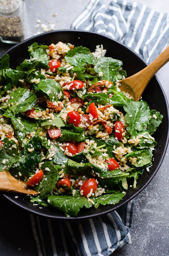 Baby Kale Salad Recipe with feta cheese, grape tomatoes, sun dried tomatoes, basil, brown rice or quinoa and easy Greek vinaigrette that makes enough leftovers and refrigerates for a few weeks. | ifoodreal.com