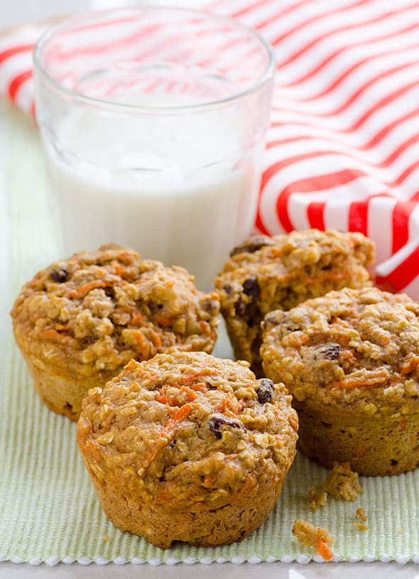 Carrot Oatmeal Muffins Recipe made healthy and moist with applesauce, oats, whole wheat flour and honey.