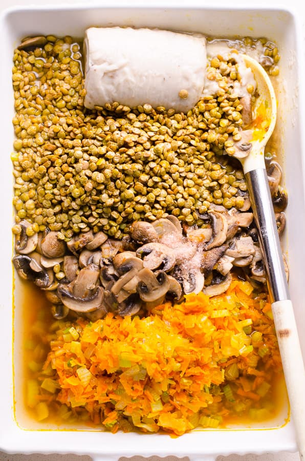 This lentil casserole is a cheesy vegetarian lentil bake recipe with brown mushrooms, green lentils, carrots, onions and celery, baked to a hearty healthy casserole perfection with melted cheese on top. | ifoodreal.com