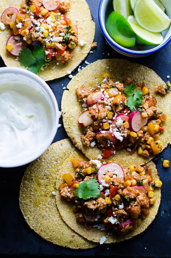 30 Minute Ground Chicken Tacos Recipe loaded with vegetables and all fixins in one skillet for a healthy taco family meal. | ifoodreal.com