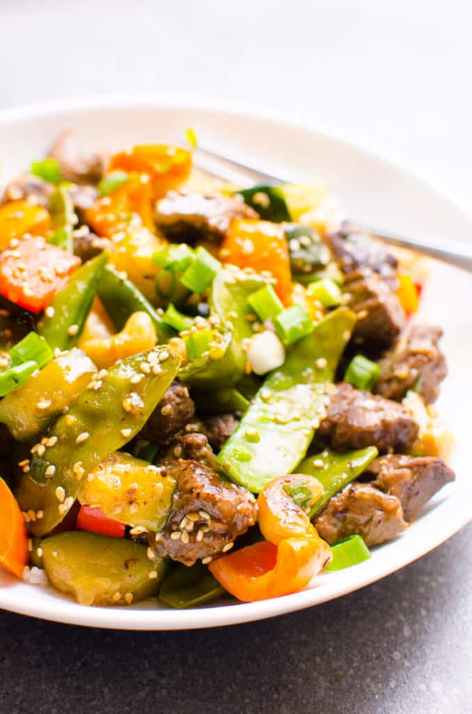 healthy beef stir fry on a white plate