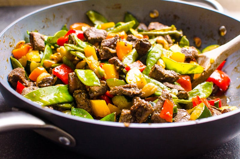 How to make easy and healthy Beef Stir Fry at home with zucchini, bell pepper, snap peas, cashews and delicious homemade sauce. Everyone will love this restaurant quality stir fry recipe!