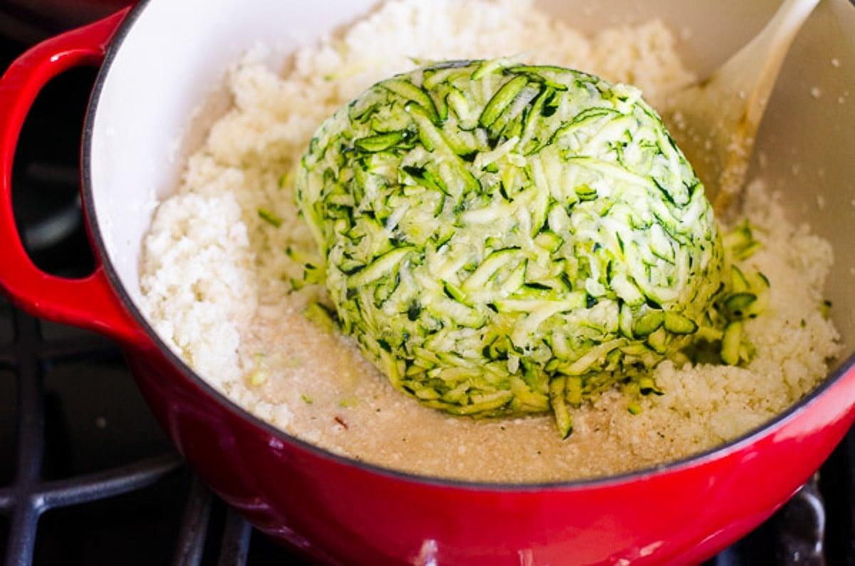 Zucchini added to cauliflower rice in dutch oven