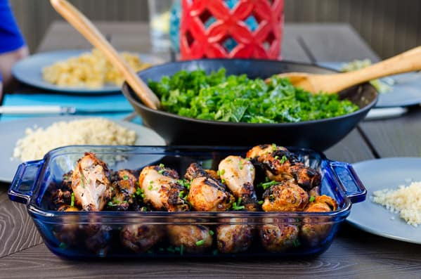 miso marinated chicken, kale salad and rice on blue plates on table