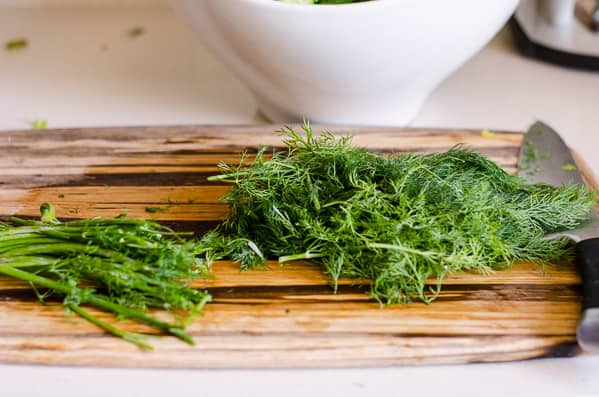 bunch of dill on cutting board