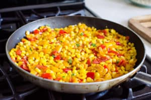 sauteed corn and veggies in a skillet