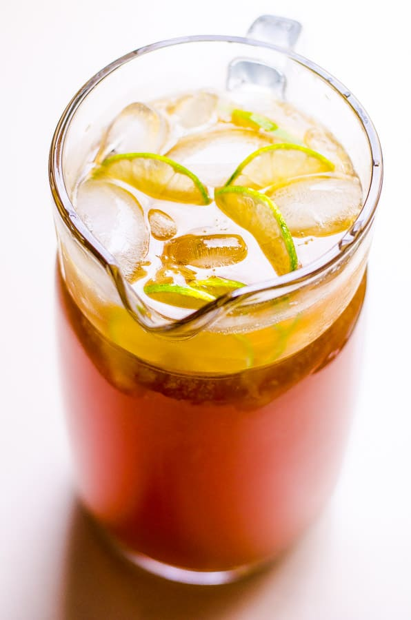 Lime Iced Tea in a pitcher with ice and slices of lime