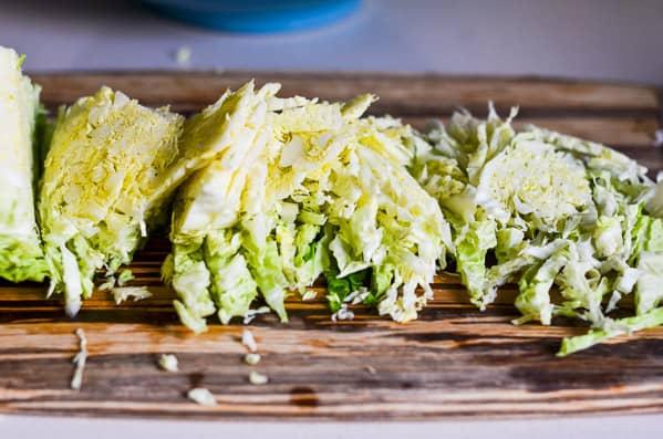 shredded savoy cabbage on cutting board