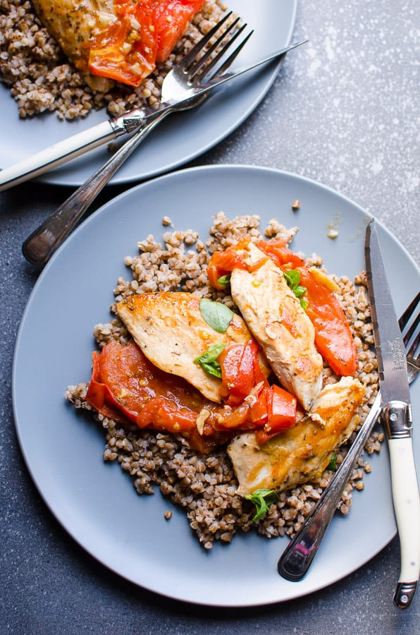 Tomato chicken served with buckwheat on a plate