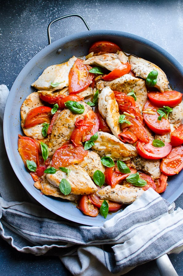 Chicken Breast with Tomatoes is 30 minute healthy dinner recipe with quickly seared chicken tenders, then sautéed with fresh tomatoes, garlic and oregano. | ifoodreal.com