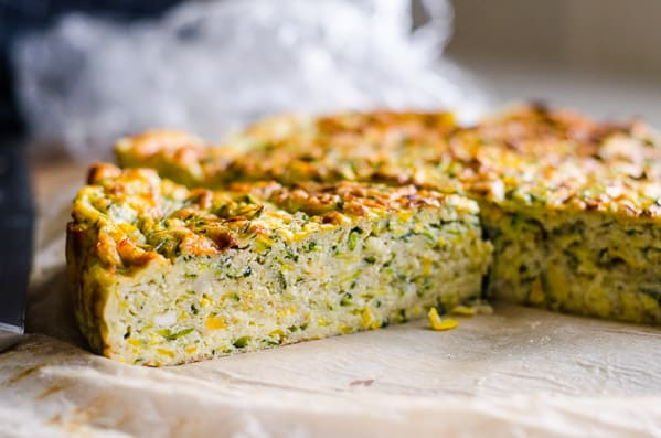 Crustless Zucchini Quiche Recipe made healthy with few ingredients like grated zucchini, Parmesan cheese, eggs and whole wheat flour. Tastes so good cold! | ifoodreal.com