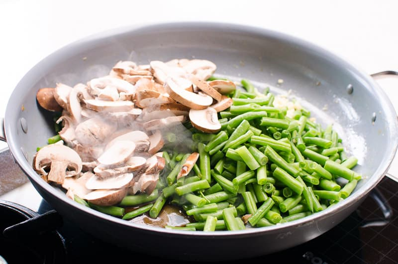 mushrooms and green beans in a skillet