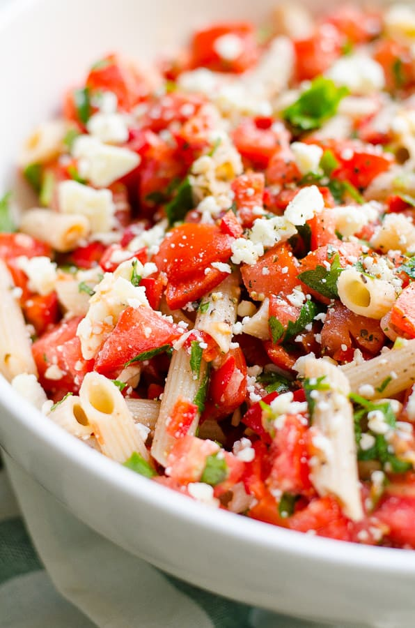 Tomato Pasta Salad Recipe made healthy with whole wheat or gluten free pasta, tomatoes, bell peppers, feta cheese, fresh parsley or dill and garlic.