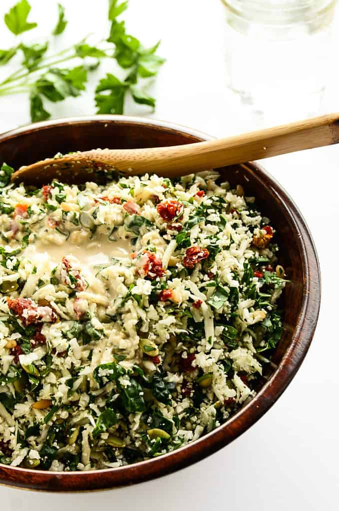 Cauliflower Tomato Detox Salad in bowl served with wooden spoons
