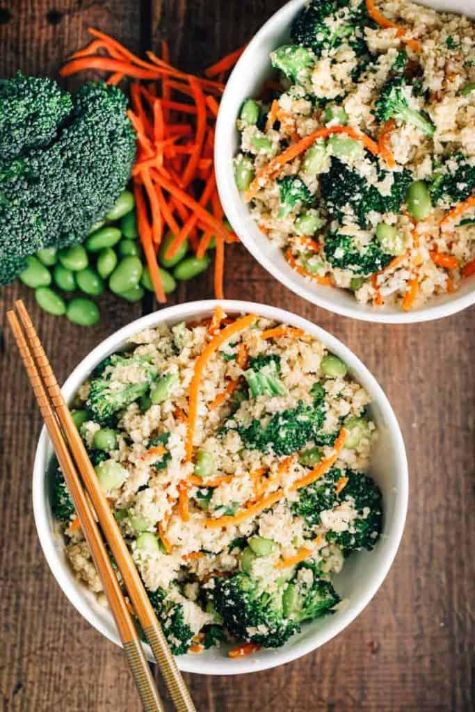 Cauliflower Rice Stir Fry Bowl in bowls with chopsticks