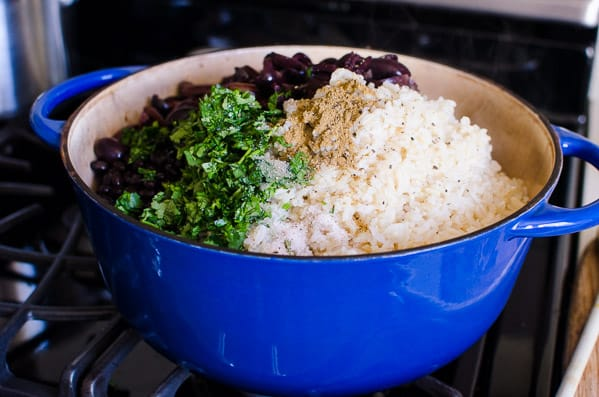 Black Beans and Brown Rice Recipe made simple and healthy with cauliflower, olives and Parmesan cheese on a stovetop in 30 minutes.   ifoodreal.com