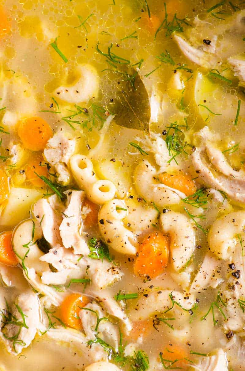 Slow Cooker Chicken Noodle Soup garnished with dill