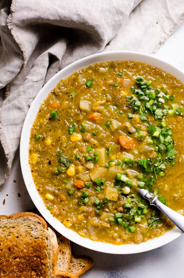 This Slow Cooker Lentil Soup is the best set-and-forget healthy vegetarian soup with hearty texture and umami flavour. Just turn on your crockpot and walk away.