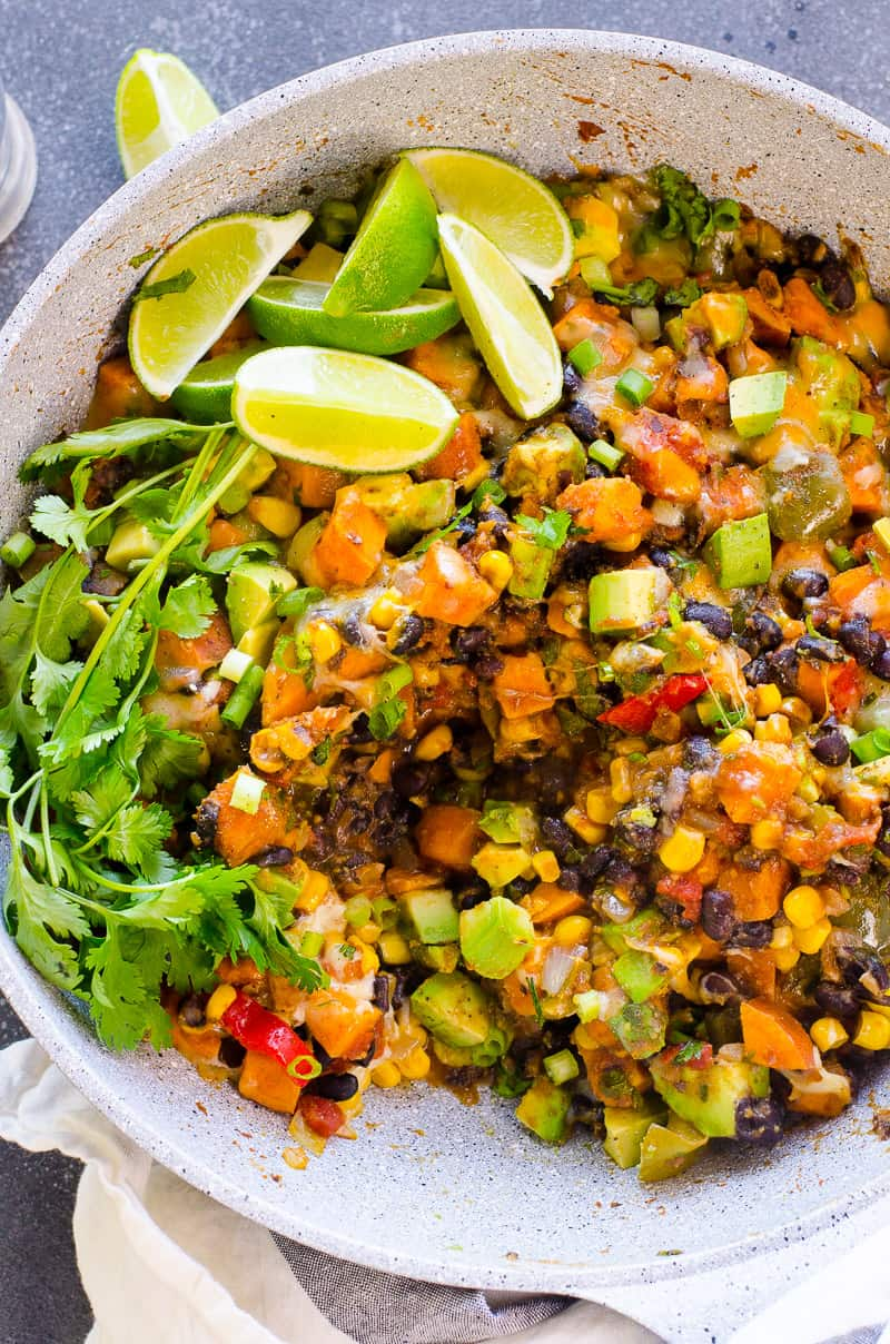 30 Minute Sweet Potato Skillet Recipe is healthy and delicious vegetarian dinner with beans and corn, fresh lime juice and melted cheese on top. To die for!