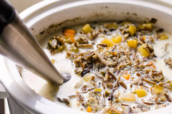 Healthy Chicken Wild Rice Soup Recipe made with no cream or flour but still so creamy, and so easy to throw in slow cooker or make easy on stovetop. | ifoodreal.com