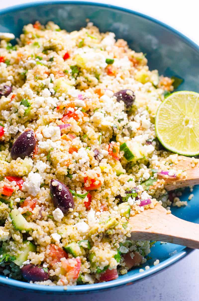 Mediterranean Quinoa Salad Recipe with quinoa, tomatoes, cucumbers, feta cheese and olives. Packed with protein, fiber and flavour healthy and easy dinner, meal prep or party salad.