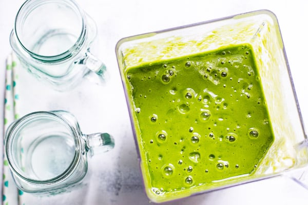 Best Green Smoothie Recipe with only 4 ingredients like water, frozen mango, spinach and kale. Your kids will drink it and it tastes good the next day.