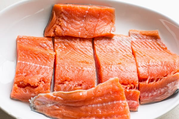 sockeye salmon fillets in a white dish