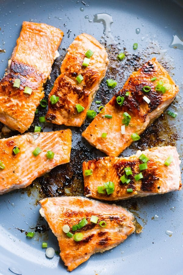 caramelized honey garlic salmon garnished with green onion