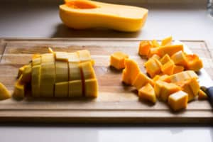 cubed butternut squash on a cutting board