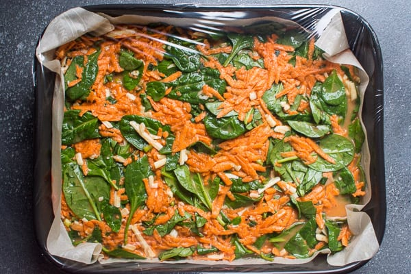Sweet Potato Breakfast Casserole unbaked and covered with plastic wrap