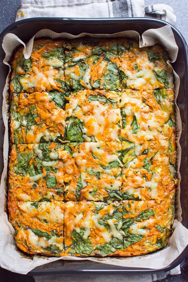Healthy sweet potato egg bake with shredded sweet potato, eggs and spinach. Also an overnight breakfast casserole perfect for brunch and holidays.