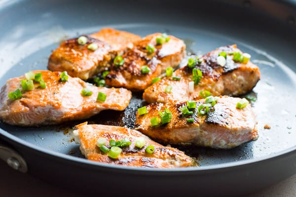 healthy honey garlic salmon in a skillet