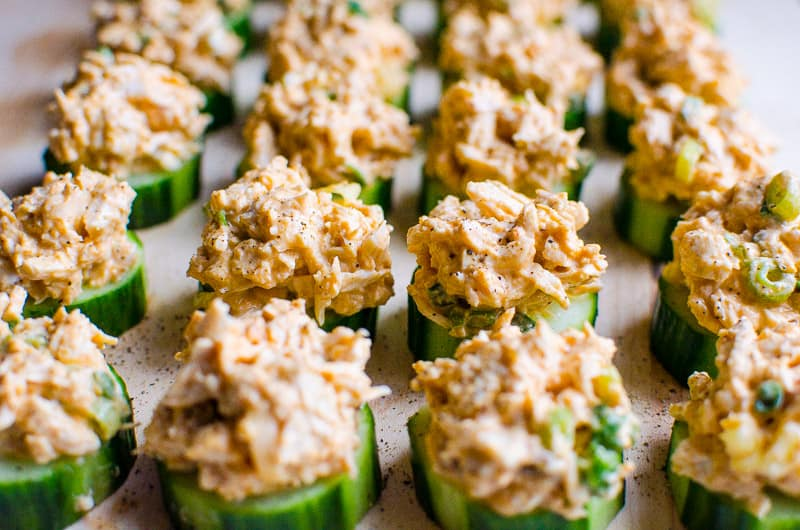 If you don't know what to serve a crowd, make these easy cucumber bites appetizers where spicy creamy chicken meets crunchy juicy cucumber. Everyone will love, guaranteed!