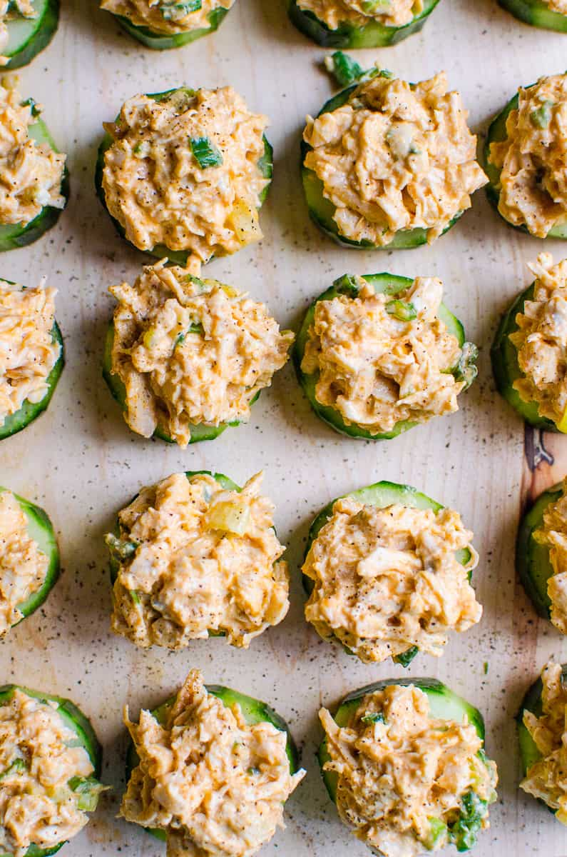 Easy Cucumber Appetizer Bites with buffalo chicken salad and garnished with black pepper