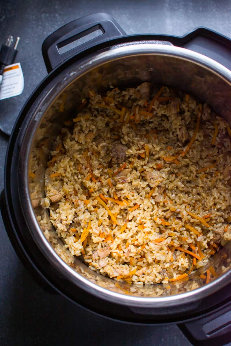 Healthy Instant Pot Chicken and Rice Recipe with boneless chicken breast or thighs and brown rice cooked in one pot of electric pressure cooker. Comes out perfect every time!