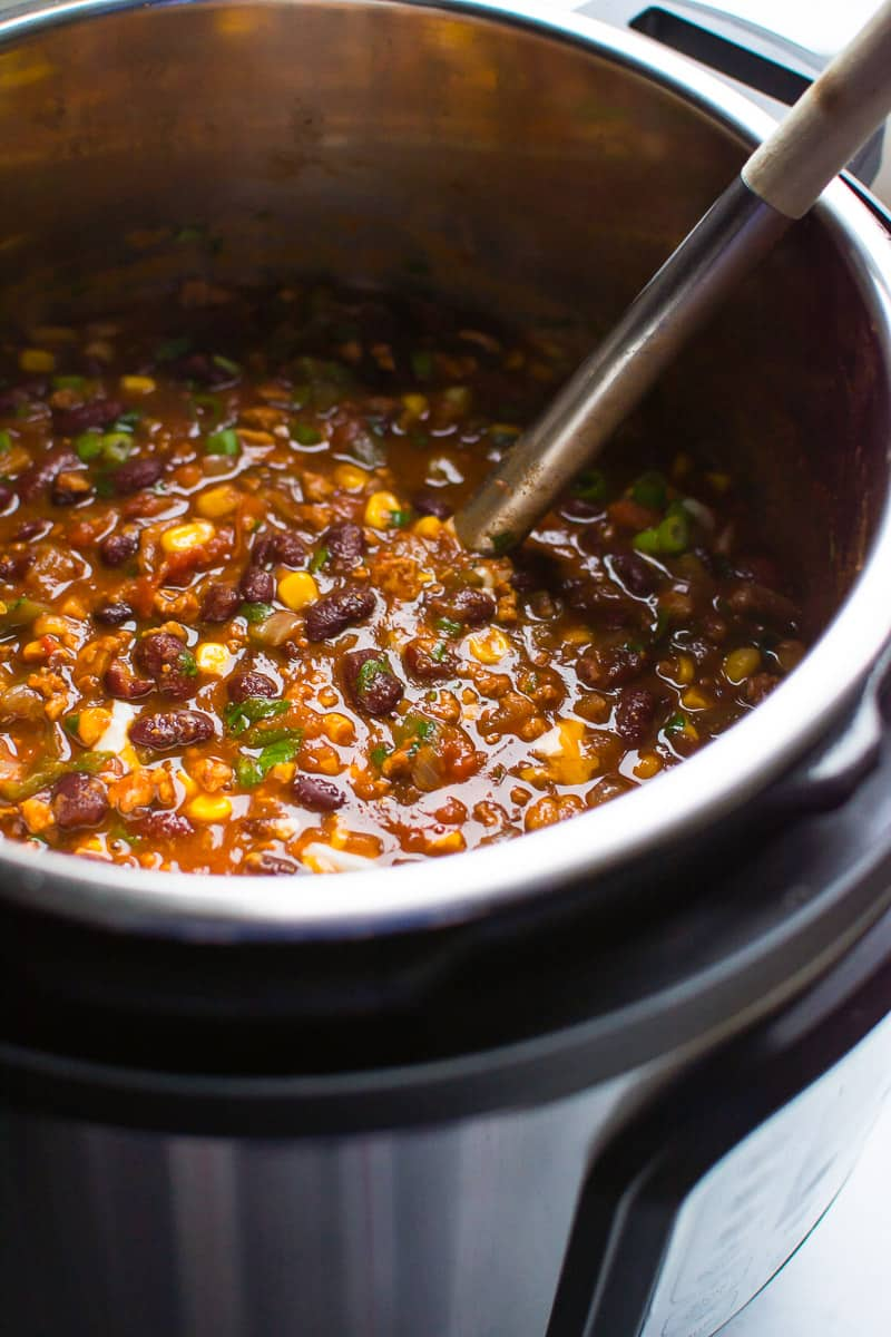Instant Pot Chili Recipe with canned beans, ground turkey and tons of vegetables made effortlessly in pressure cooker but tastes like it has been simmering all day. #ifoodrealmonthly