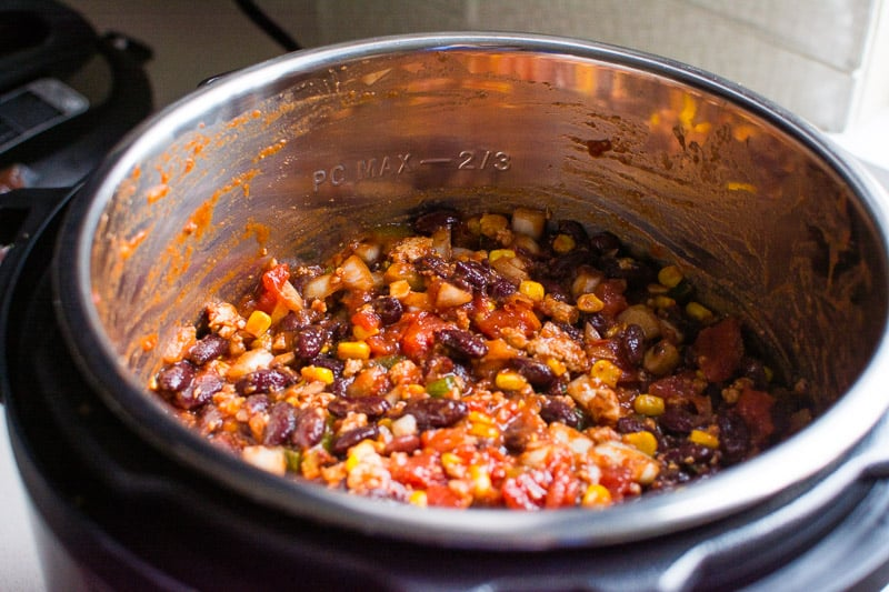 Instant Pot Chili Recipe with canned beans, ground turkey and tons of vegetables made effortlessly in pressure cooker and tastes like it has been simmering all day.