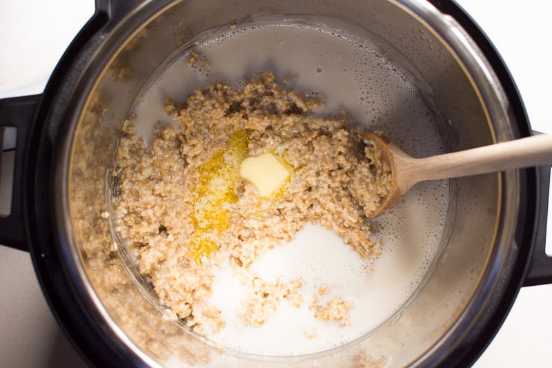 butter and milk added to the pot with oats