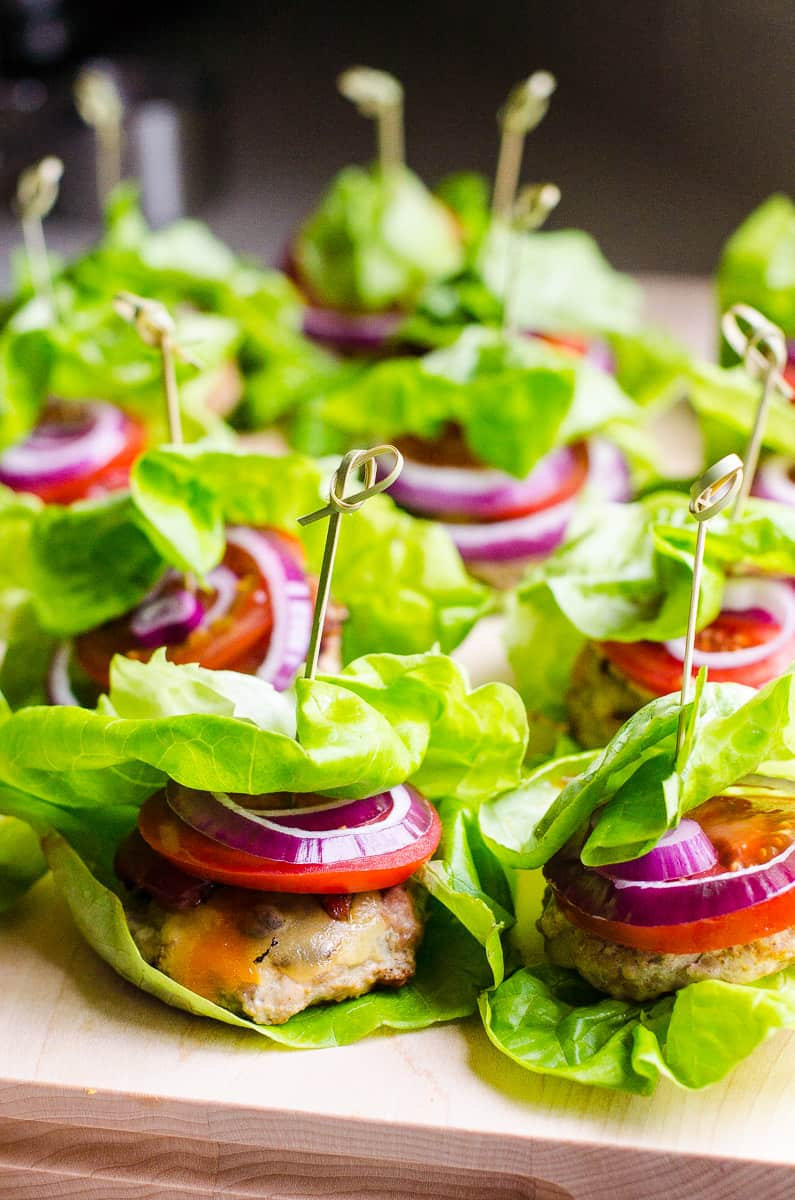 These Healthy Turkey Sliders are fast, juicy and flavourful. With a bit of bacon, cheese and traditional fixings, everyone will love wrapped in lettuce mini burgers.